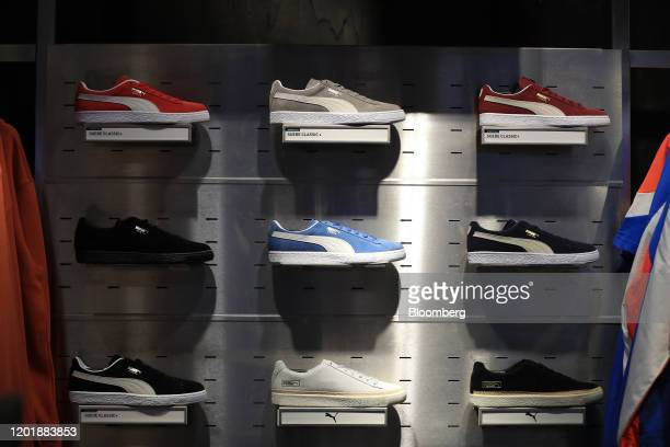 Range of Puma Suede Classic sneakers sit on display inside the Puma SE concept store in Herzogenaurach, Germany, on Wednesday, Feb. 19, 2020. Puma...