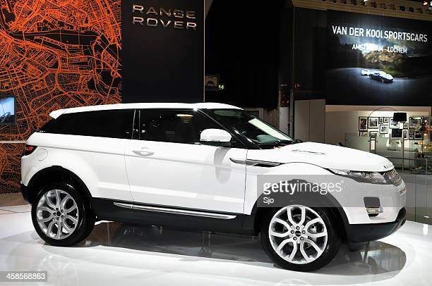 range rover evoque crossover suv side view - range rover stock pictures, royalty-free photos & images
