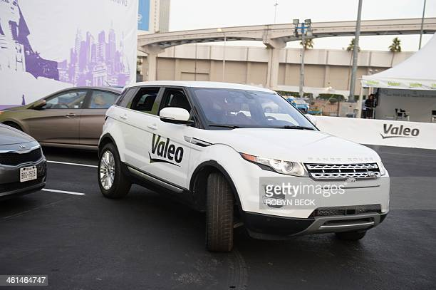 A Range Rover Evoque equipped with Valeo selfparking technology backs into a parking spot during a driverless car demo at the 2014 International CES...