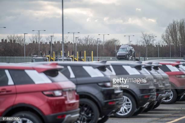 Range Rover EvoqueSport sport utility vehicles and Land Rover Discovery Sport sport utility vehicles sit outside Jaguar Land Rover Plc's assembly...
