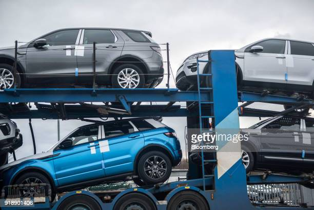 Range Rover EvoqueSport sport utility vehicles and Land Rover Discovery Sport sport utility vehicles sit on a transporter outside Jaguar Land Rover...