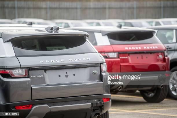 Range Rover EvoqueSport sport utility vehicles sit outside Jaguar Land Rover Plc's assembly plant a unit of Tata Motors Ltd in Halewood UK on Monday...