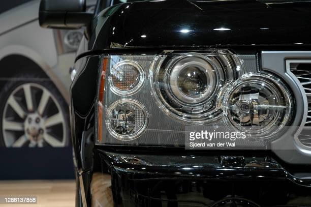Range Rover Sport luxury SUV car headlight on display at Amsterdam motor show AutoRAI on February 9, 2005 in Amsterdam, The Netherlands.