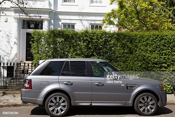 Range Rover SUV parked in an exclusive residential street scene in Kensington In a selected few boroughs of West London wealth has changed over the...