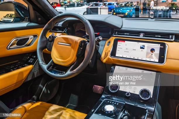 Range Rover Velar crossover luxury SUV dashboard on display at Brussels Expo on January 9, 2020 in Brussels, Belgium. The Velar is available with...