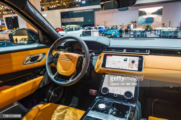 Range Rover Velar crossover luxury SUV interior on display at Brussels Expo on January 9, 2020 in Brussels, Belgium. The Velar is available with...