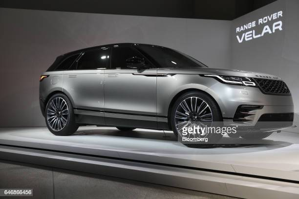 A Range Rover Velar Sports Utility Vehicle Manufactured By Jaguar Land Automotive Plc Stands During