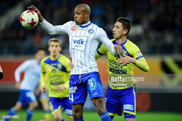Rangela Janga forward of KAA Gent holds off the challenge of Sasha Kotysch defender of STVV during the Jupiler Pro League match between KAA Gent and...