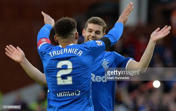 Ranger captain James Tavernier celebrates with team mates Jonathon Flanagan at the final whistle as Rangers beat Celtic 10 during the Ladbrokes...