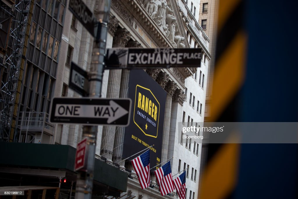 Ranger Energy Services Inc. signage is displayed outside of the New York Stock Exchange (NYSE) during the company's initial public offering (IPO) in New York, U.S., on Friday, Aug. 11, 2017. U.S. stocks halted a three-day slide, volatility eased and Treasuries slipped as markets began to stabilize after a week of verbal sparring between the U.S. and North Korea. Photographer: Michael Nagle/Bloomberg via Getty Images