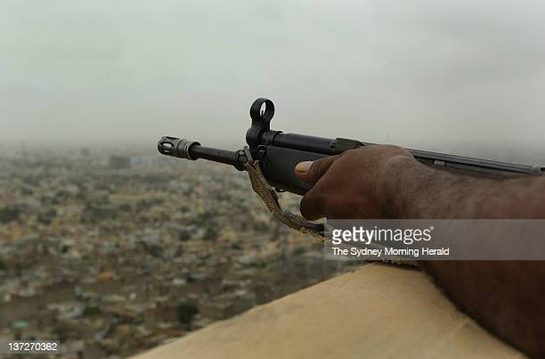 A ranger in the Pakistani military surveys the Qasba area of Karachi on August 11 2011 which is home to many Awami National Party supporters The area...
