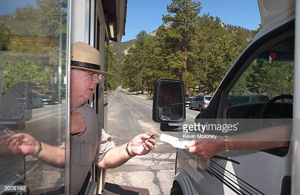 Ranger Marv Rutkowski welcomes visitors May 23 2003 in Rocky Mountain National Park Colorado The park is anticipating It's third busiest weekend next...