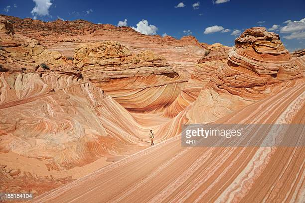 Ranger walking through the Wave - Sandstone Wonder (XXXL)