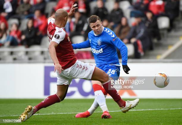 Rangers' Albanian forward Florian Kamberi vies with Sporting Braga's Brazilian defender Raul during the UEFA Europa League round of 32 second leg...