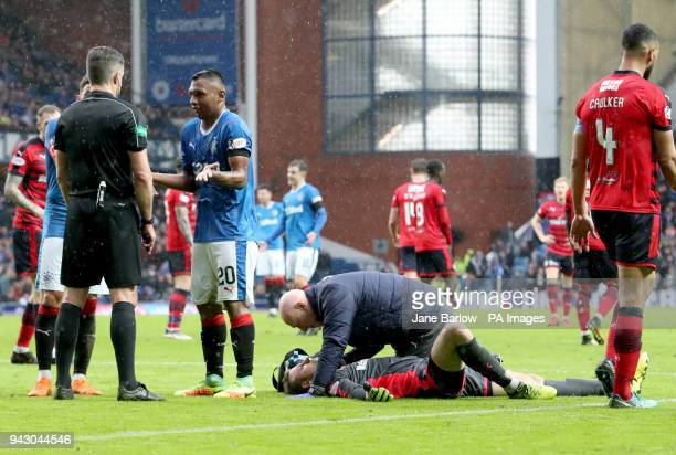 Rangers' Alfredo Morelos appeals to referee Greg Aiken after receiving a yellow card from after colliding with Dundee goalkeeper Elliot Parish during...
