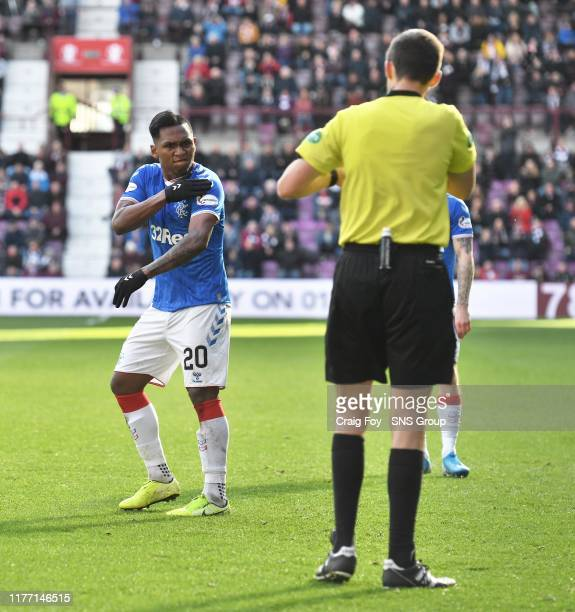 Rangers' Alfredo Morelos complains to referee Kevin Clancy after being booked during the Ladbrokes Premiership match between Heart of Midlothian and...