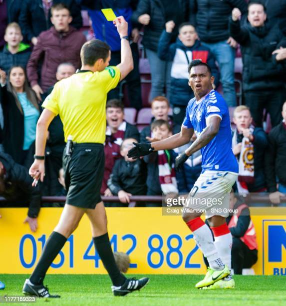 Rangers' Alfredo Morelos is booked by referee Kevin Clancy during the Ladbrokes Premiership match between Heart of Midlothian and Rangers at...