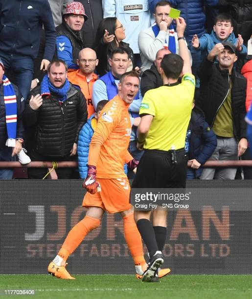 Rangers' Allan McGregor is booked by referee Kevin Clancy during the Ladbrokes Premiership match between Heart of Midlothian and Rangers at...