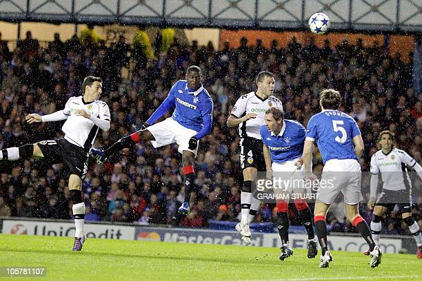 Rangers' American midfielder Maurice Edu scores an own goal for Valencia during a UEFA Champions League Group C football match at Ibrox Stadium...