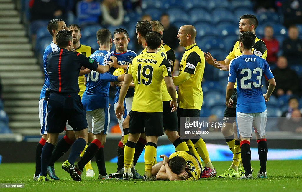 Rangers and Livingston players confront each other as Kieran Gibbons of Livingston lies on the ground during the Petrofac Training Cup Quarter-Final match between Rangers and Livingston at Ibrox Stadium on October 20, 2015 in Glasgow, Scotland.