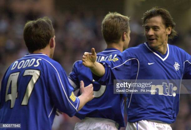 Rangers Andrei Kanchelskis celebrates with Billy Dodds after Dodds scores the second goal against Hibernian in their Scottish Premier league football...