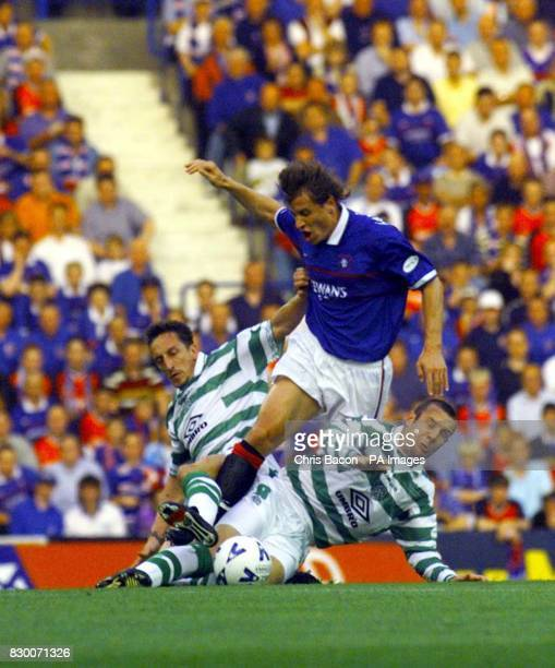 Ranger's Andrei Kanchelskis fights his way through the Celtic's Graig Burley and Stephane Mahe during the Old Firm game at Ibrox today Photo by Chris...