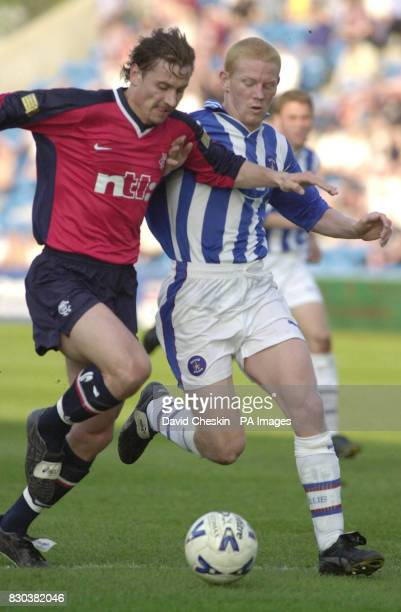 Rangers Andrei Kanchelskis holds off Kilmarnock`s Gary Holt in their Scottish Premier League football match at the Rugby Park stadium in Kilmarnock