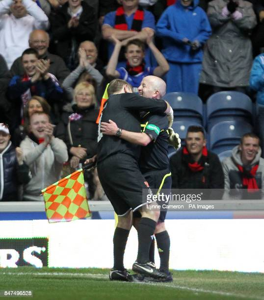 Ranger's Andy Goram hugs the linesman John Gilmour after he gives a AC Milan goal offside during the Legends match at Ibrox Stadium Glasgow