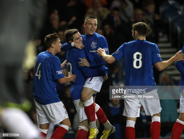 Ranger's Andy Little celebrates with Barrie McKay Lewis MacLeod and Kyle Hutton during the Irn Bru Scottish Division Three match at Ibrox Glasgow