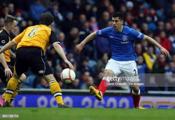 Rangers Anestis Argyriou holds off Annan Athletic's Scott Chaplain during the IrnBru Scottish Third Division match at Ibrox Glasgow