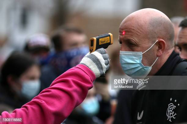 Rangers assistant manager Gary McAllister is seen wearing a face mask whilst he has a temperature check prior to the Ladbrokes Scottish Premiership...