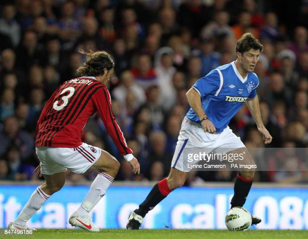 Ranger's Brian Laudrup and AC Milan's Paolo Maldini during the Legends match at Ibrox Stadium Glasgow