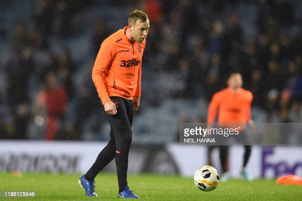 Rangers' Canadian-Scottish midfielder Scott Arfield warms up before during the UEFA Europa League Group G football match between Rangers FC and BSC...