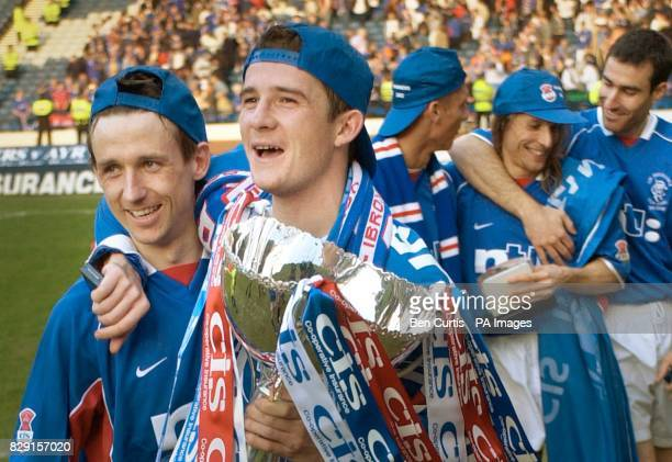 Rangers' captain Barry Ferguson holds the cup with Neil McCann as the team celebrate their 30 win over Ayr United in the CIS Insurance League Cup...