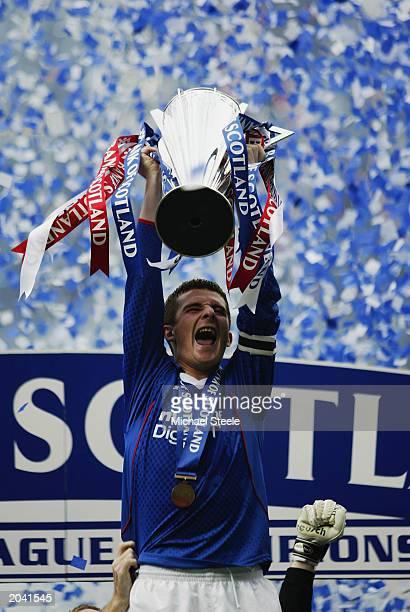 Rangers captain Barry Ferguson lifts the trophy up as he celebrates winning the league after the Bank of Scotland Premier League match between...