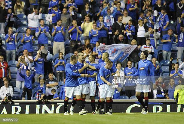 Rangers' captain david Weir is congratulated by his team mates after scoring the winning goal during their friendly soccer match at Ibrox Stadium in...