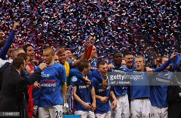 Rangers celebrate wining the Cooperative Insurance Cup after beating Celtic 21 in the final at Hampden Park on March 20 2011 in Glasgow Scotland