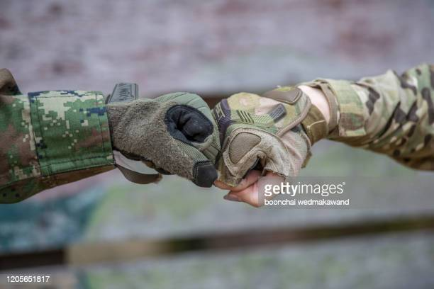 rangers celebrating success, clapping with hands. team work conceptual image. soldier shaking hands .    0220 - officer military rank stock pictures, royalty-free photos & images