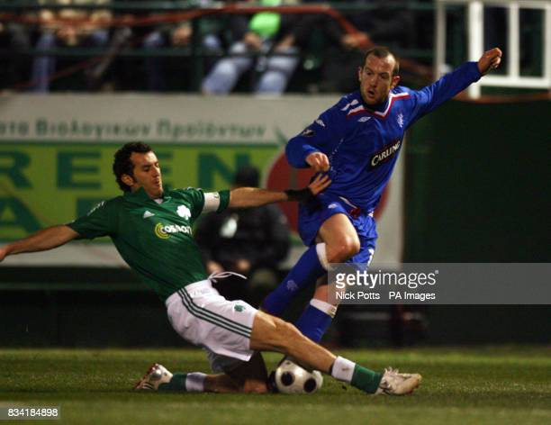 Rangers Charlie Adam is tackled by Panathinaikos' captain Ioannis Goumas during the UEFA Cup match at Apostolos Nikolaidis Stadium Athens Greece