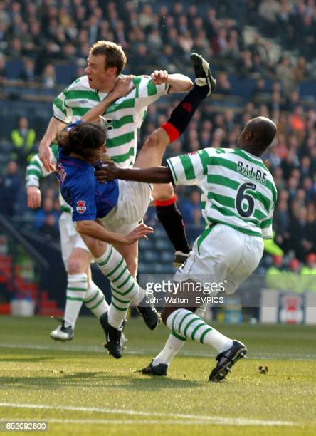 Rangers' Claudio Caniggia battles for the ball with Celtic's Joos Valgaeren and Bobo Balde