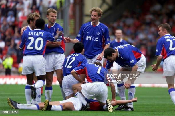 Rangers' Claudio Caniggia celebrates with teammates after scoring his first goal against Aberdeen during the Bank Of Scotland Scottish Premier League...