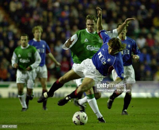 Ranger`s Claudio Caniggia comes under pressure from Hibernian`s Grant Brebner during their Scottish Premier league match at the Easter rd stadium in...