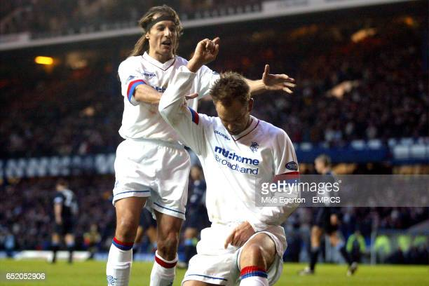 Rangers' Claudio Caniggia congratulates teammate Ronald De Boer on scoring