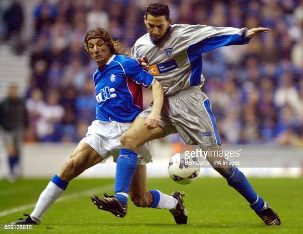 Rangers' Claudio Caniggia fights for the ball with Dunfermline's Youssef Rossi during the Bank of Scotland Scottish Premier League game between...