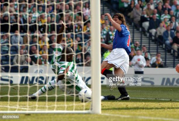 Rangers' Claudio Caniggia gets the ball past Celtic's Dianobo Balde to score the opening goal