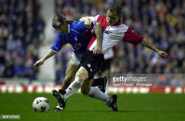 Rangers Claudio Caniggia holds off Feyenoords Thomas Rzasa during their UAFA cup 4th round 1st leg game at the Ibrox stadium in Glasgow