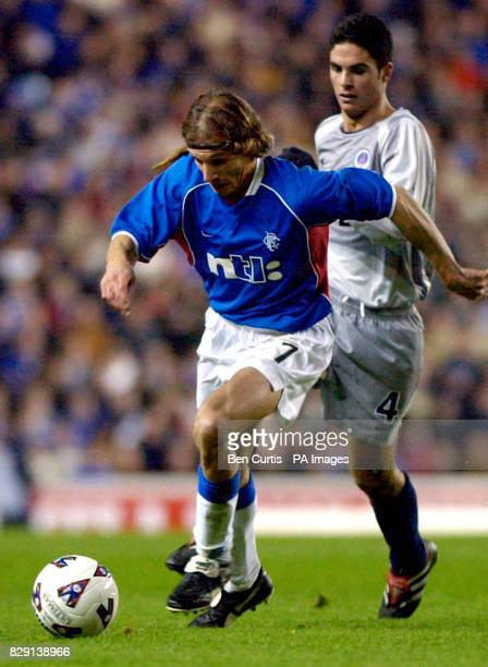Rangers' Claudio Caniggia holds off PSG's Mikel Arteta during the UEFA Cup third round first leg game between Rangers and Paris Saint Germain at...