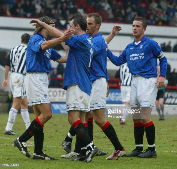Rangers' Claudio Caniggia is congratulated by teammates after scoring against Dunfermline during their Bank of Scotland Scottish Premier League match...