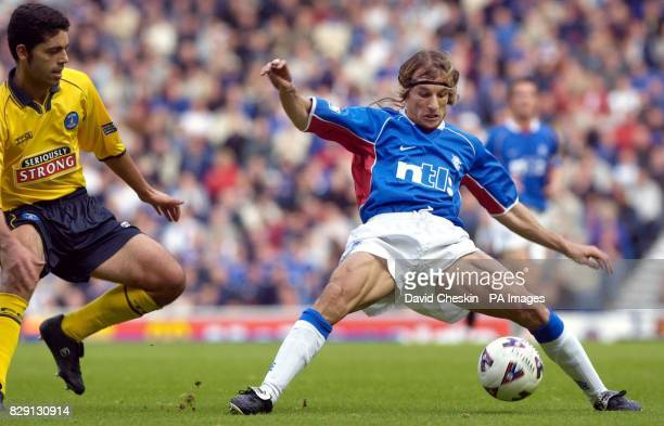 Rangers' Claudio Caniggia tries to avoid slipping as Kilmarnock's Jesus Sanjuan looks on during the Bank of Scotland Scottish Premier League match at...