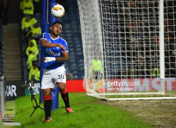 Rangers' Colombian striker Alfredo Morelos retreives the ball after failing to score during the UEFA Europa League round of 32 first leg football...